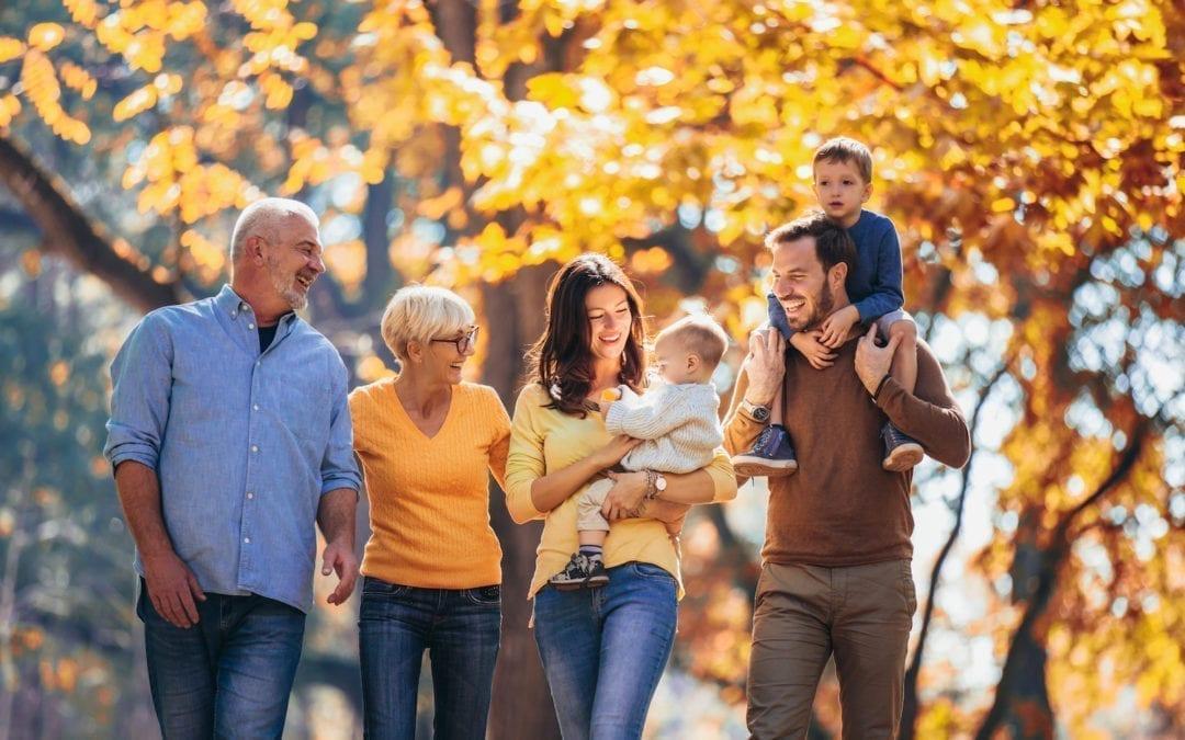 Multl generation family in autumn park having fun | North Houston