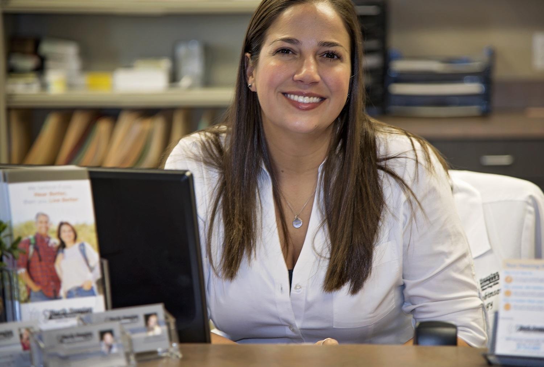 audiologist sat at desk